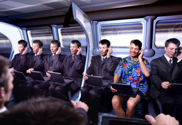 Executive in Hawaiian shirt amongst commuters