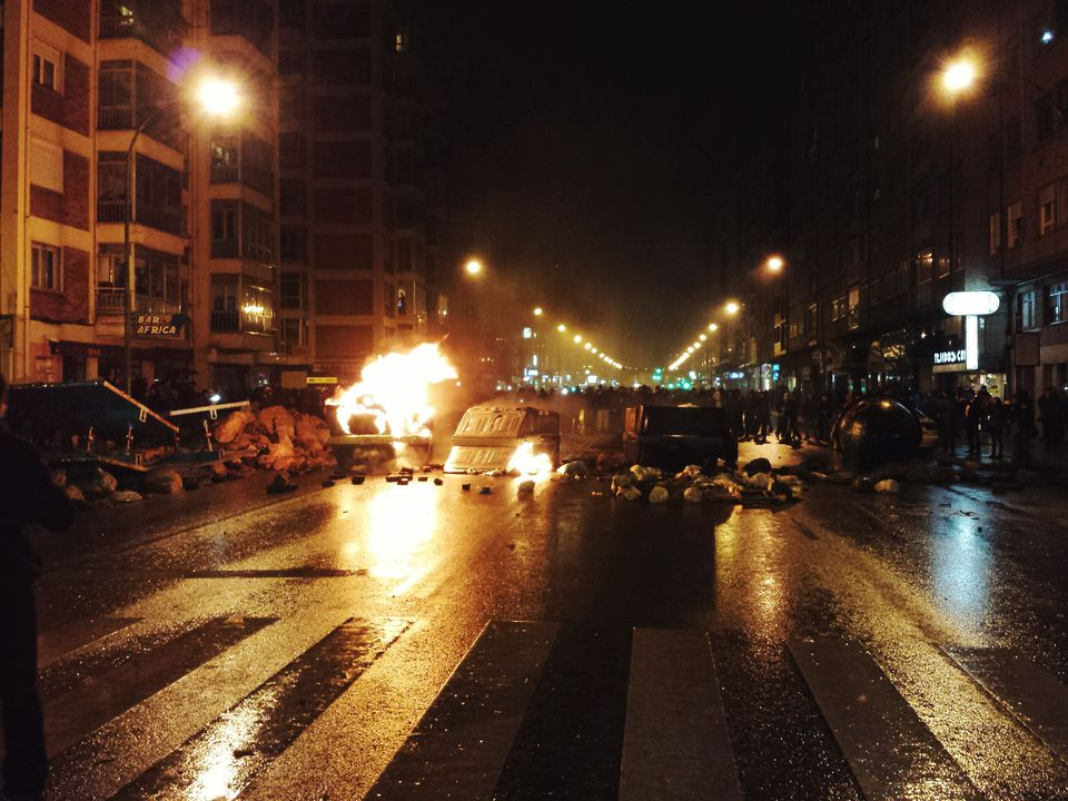Riot On Illuminated Street At Night