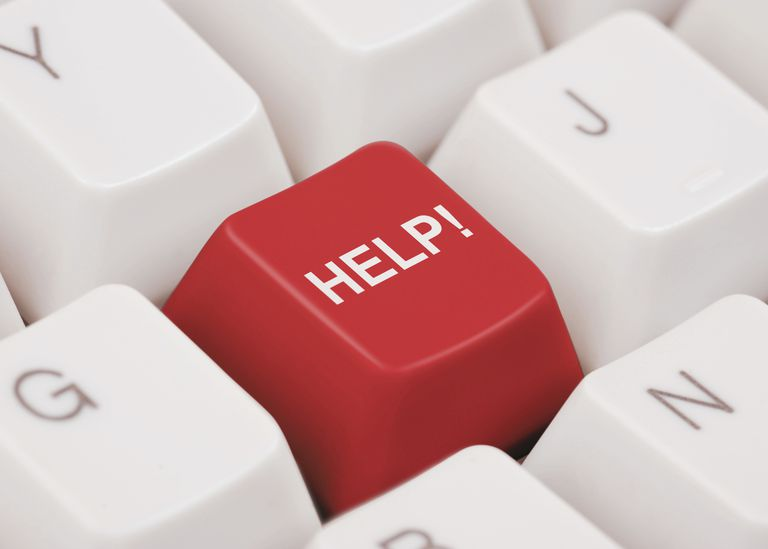 Photo of a red HELP key on a computer keyboard