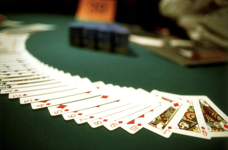 A Blackjack table with cards