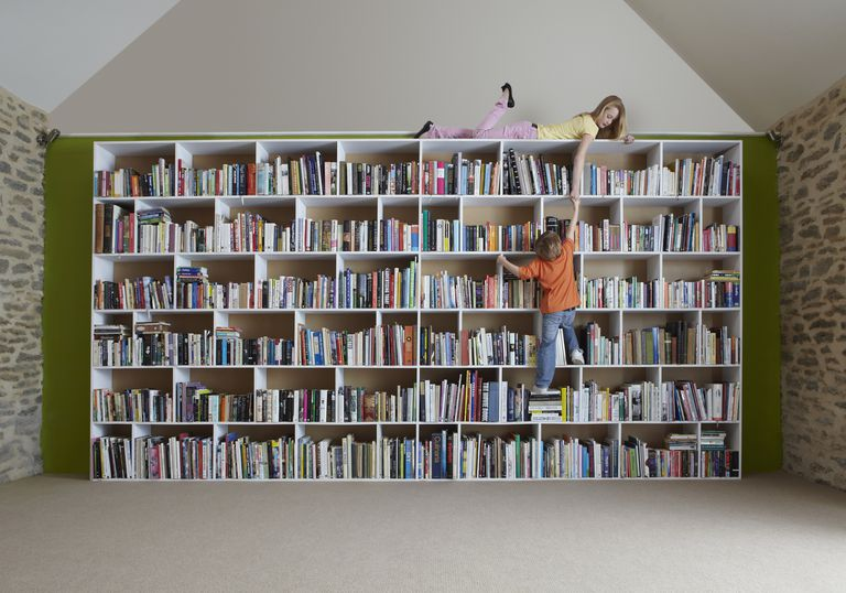 Girl And Boy On Bookcase