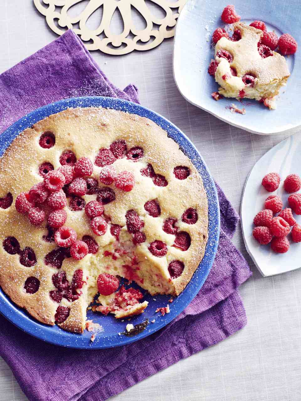 Still life of Czech bublanina cake with raspberries