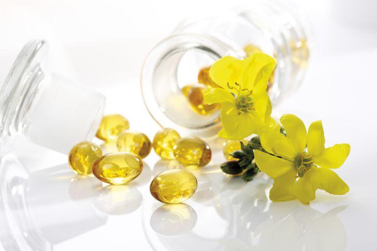Evening primrose oil capsules and flowers