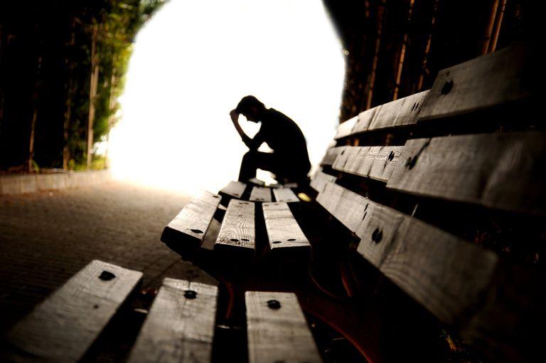 upset teen boy in a distance