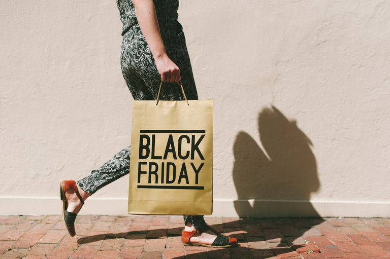 Woman walking with Black Friday shopping bag