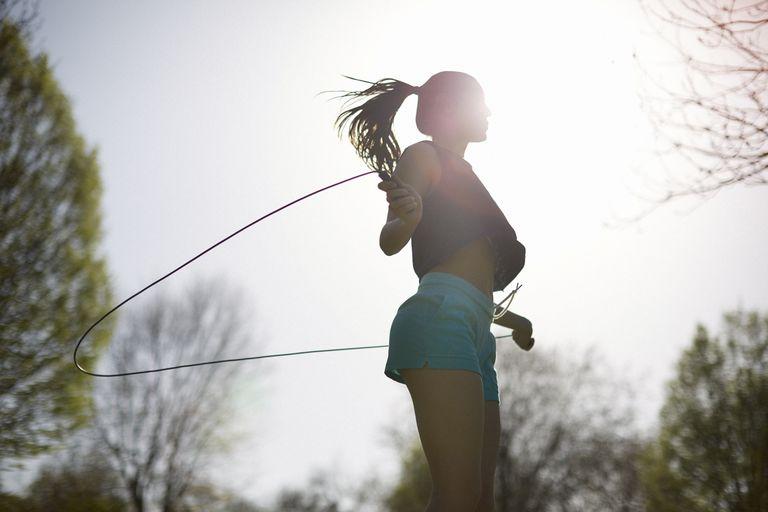 Woman Jumping Rope at Sunset