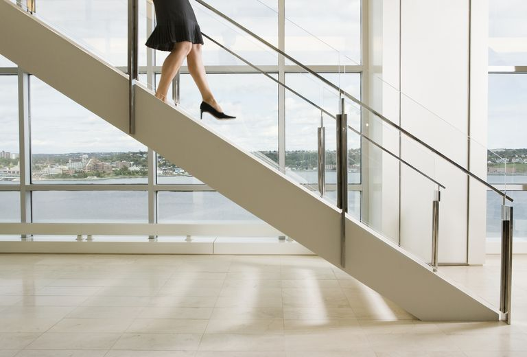 Woman-walking-down-stairs,-side-view,-low-section-Janet-Kimber.jpg
