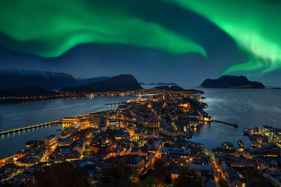 Green Aurora borealis over Alesund, Norway
