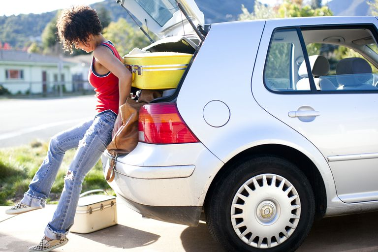 Girl packing car for college