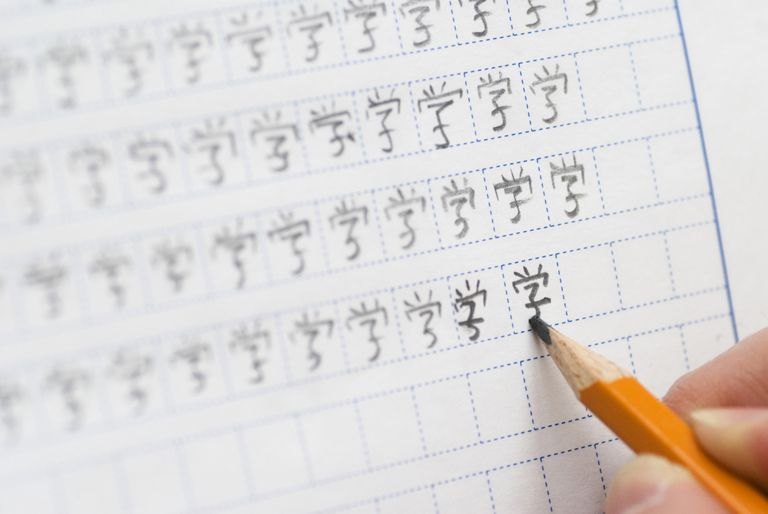 student learning to write Chinese characters