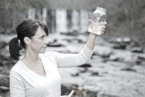 Environmental Technician testing water sample