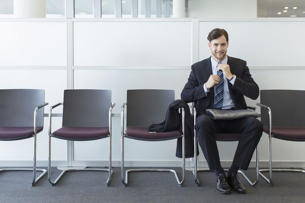man waiting for job interview in lobby