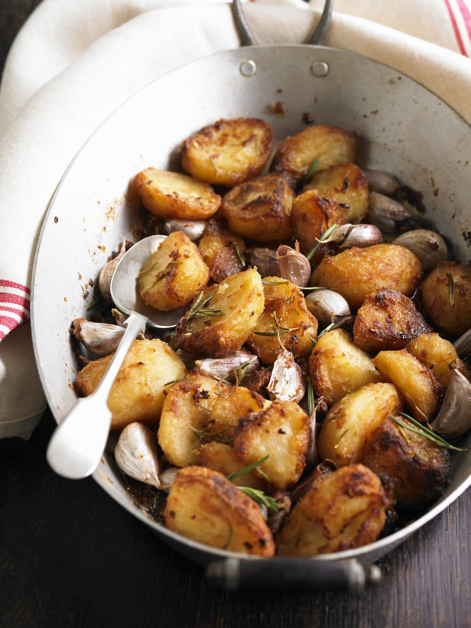 Roast potatoes with garlic and rosemary, close-up