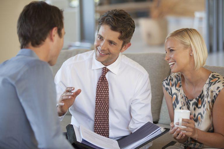 Financial advisor talking to couple on sofa