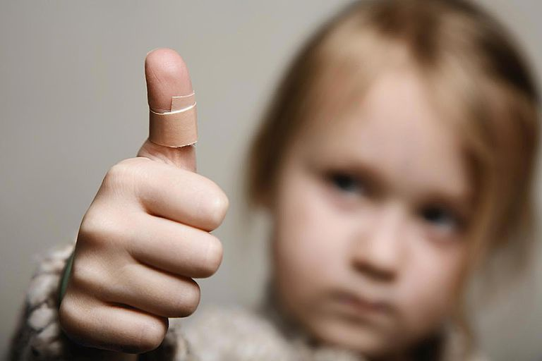 Girl with bandage on thumb