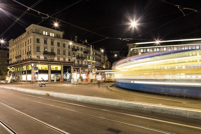 Tramway rushing at night in Zurich, Switzerland