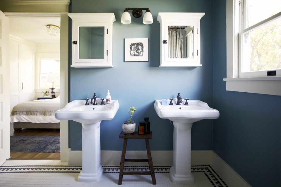 blue bathroom with double vanity