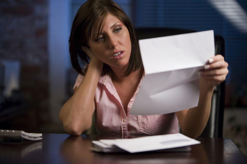 upset woman looking at bill