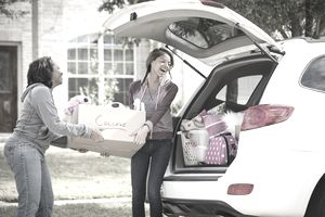 Mom Helping Daughter Pack for College