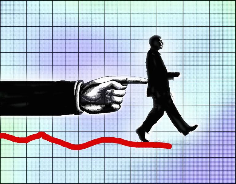 Finger pushing businessman off the end of line on graph