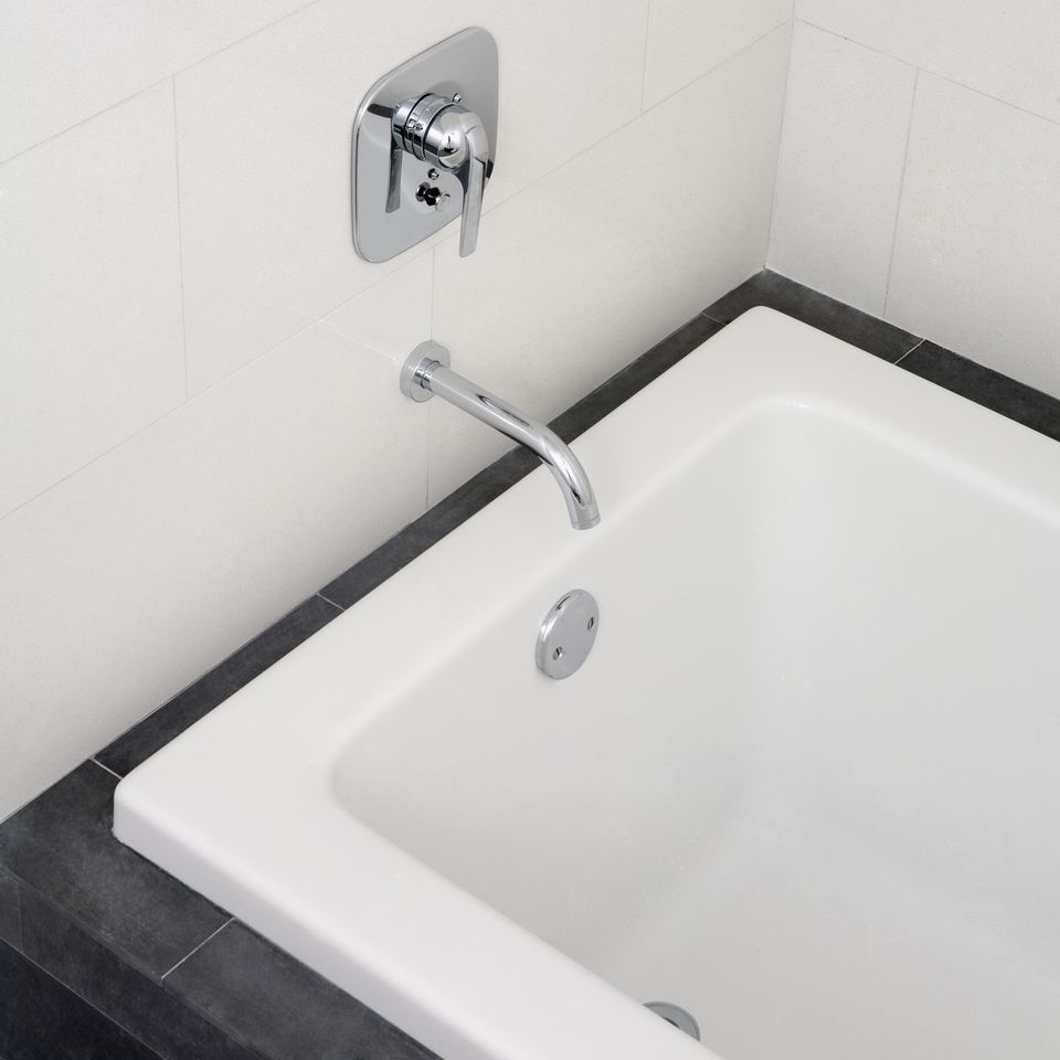 Close up of faucet and bathtub in modern bathroom