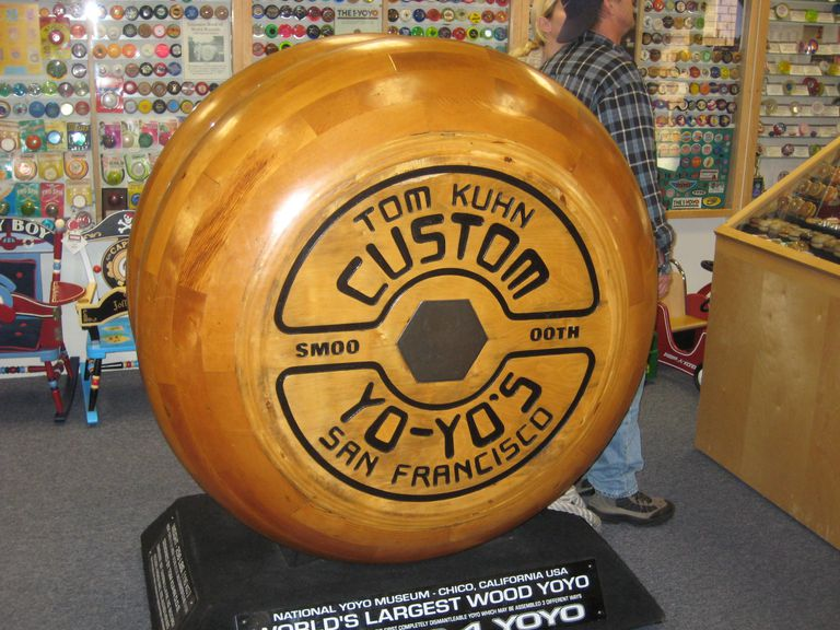 A picture of the world's largest working yo-yo, on display at the National Yo-Yo Museum.