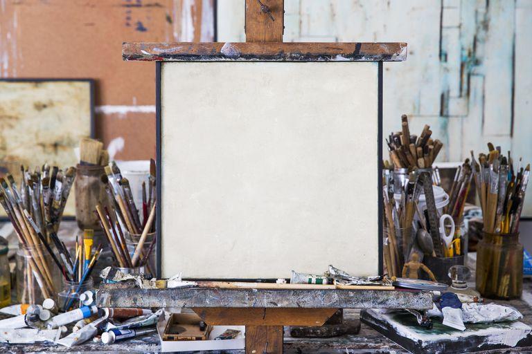 Blank art canvas in mess artist's studio