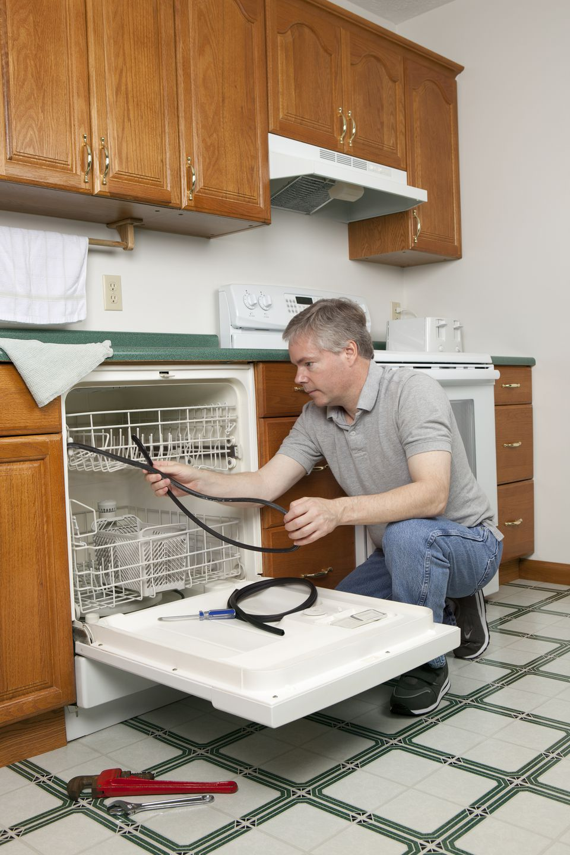 Plumber Working on Dishwasher