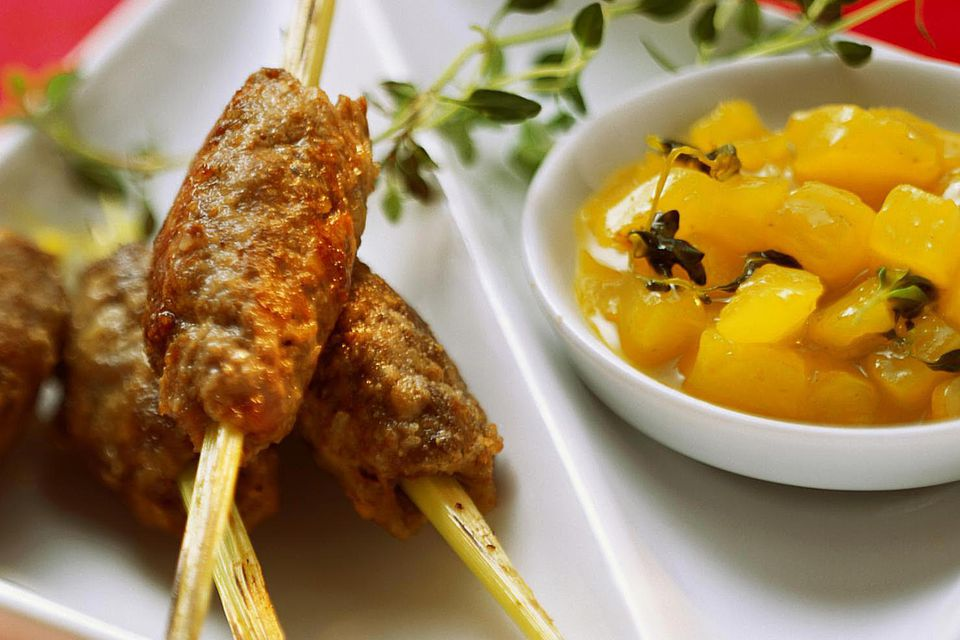 Venison rissoles on skewers with pineapple chutney