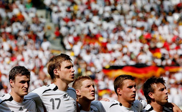 BERLIN - JUNE 20: The Germany players sing their national anthem prior to the FIFA World Cup Germany 2006 Group A match between Ecuador and Germany played at the Olympic Stadium on June 20, 2006 in Berlin, Germany.