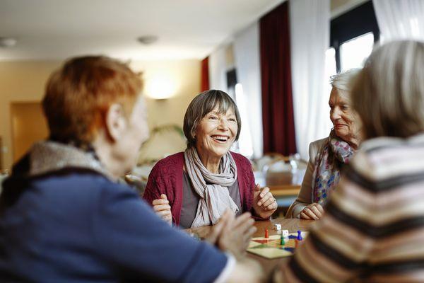 senior women playing games in nursing home