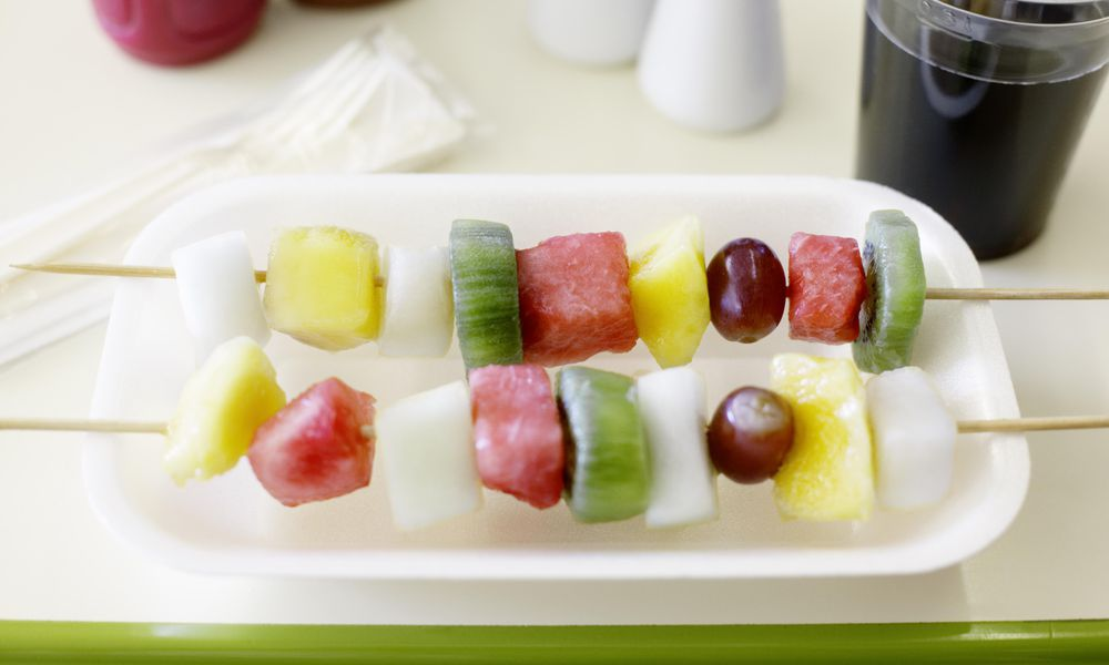 Pineapple, grapefruit, grapes and melon on kebab skewers