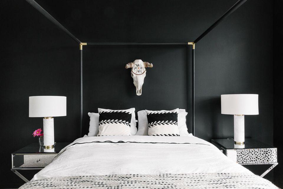 black bedroom with steer skull