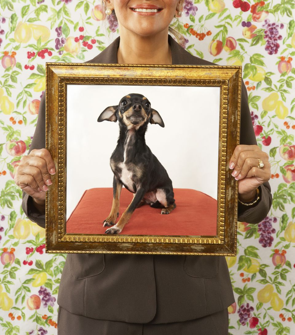 woman with photo of dog