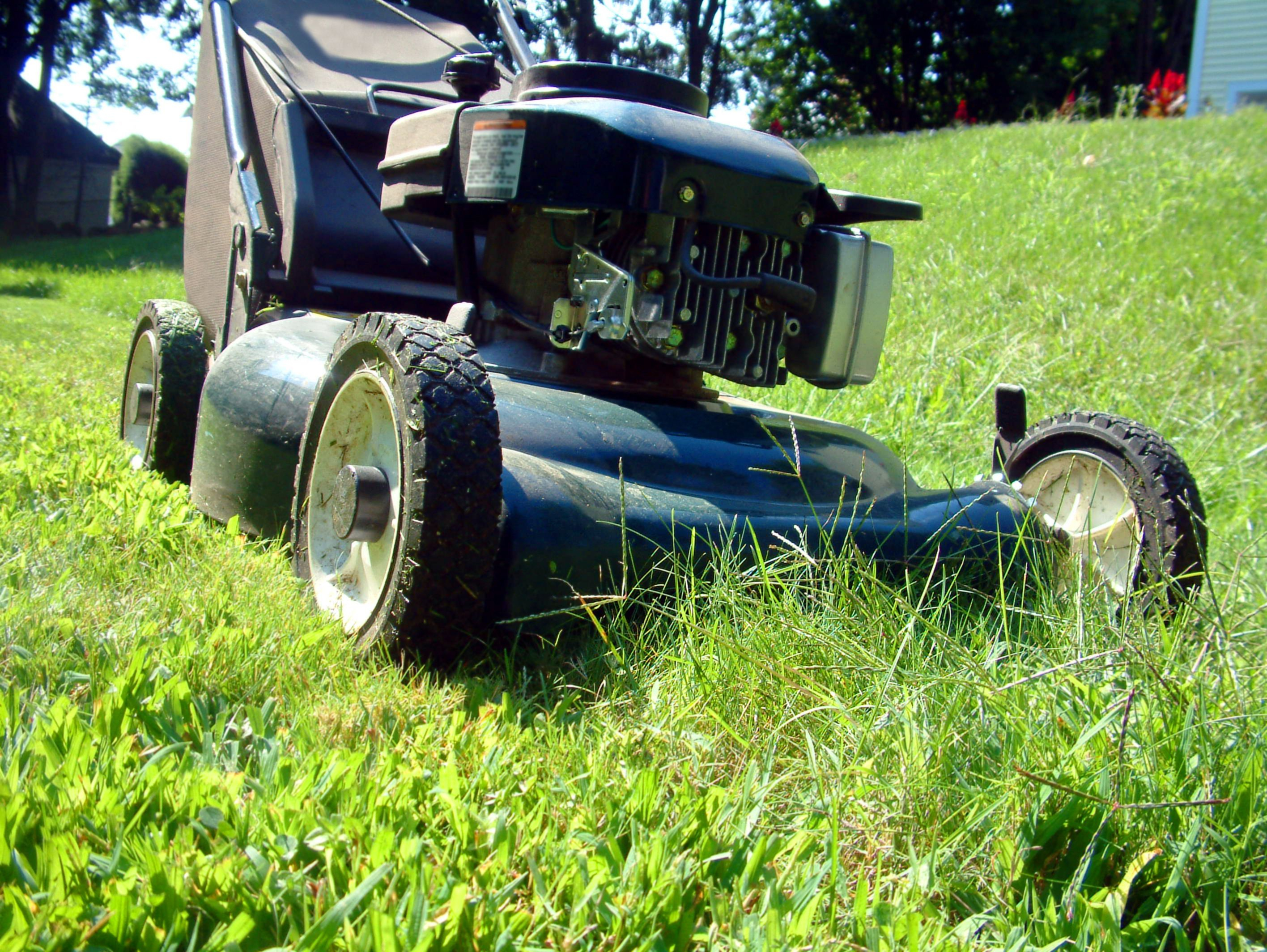 Four cycle engine lawn mower maintenance adding oil for Best motor oil for lawn mowers