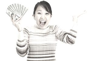 Image of a woman holding cash in her hands.