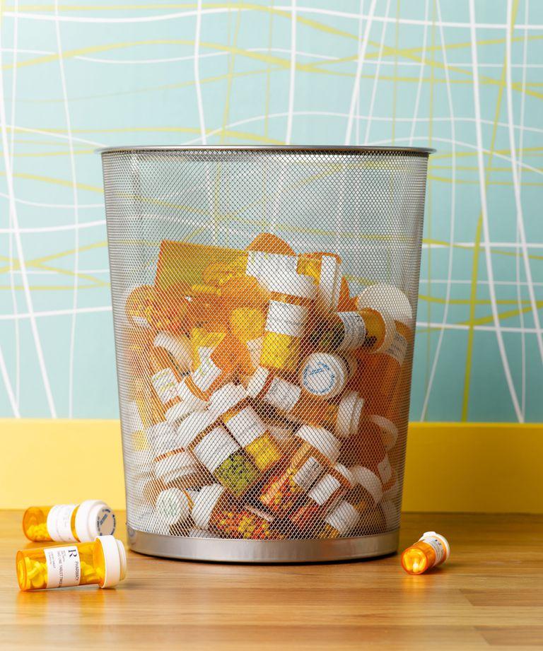 pill bottles in trash