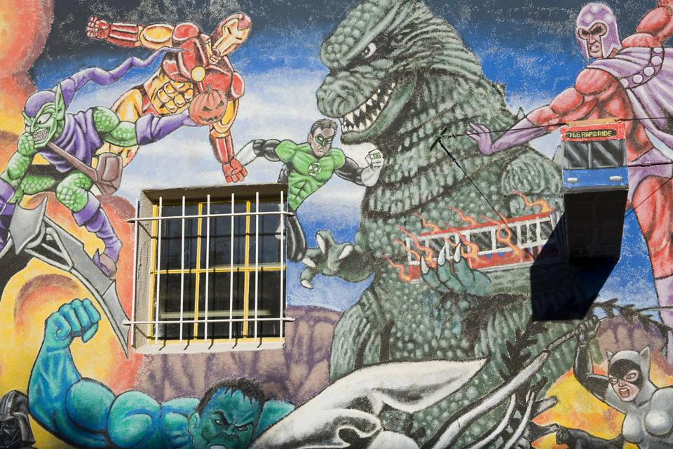 Mural on comic book store in Nob Hill District.