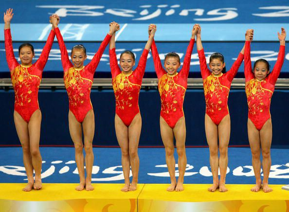 The Chinese gymnasts receive their gold medals for winning the 2008 Olympic team title in gymnastics