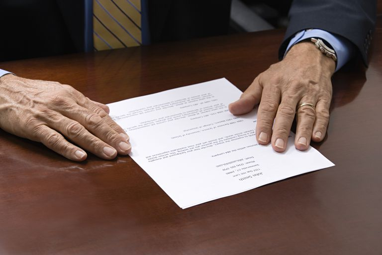resume on table with man hands