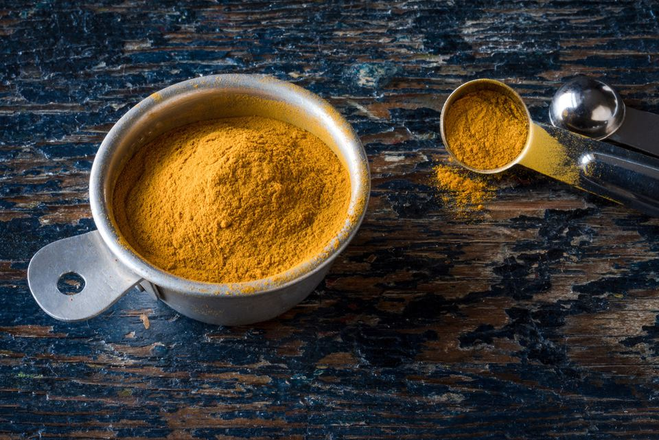 Close-Up Of Curry Powder In A Pot