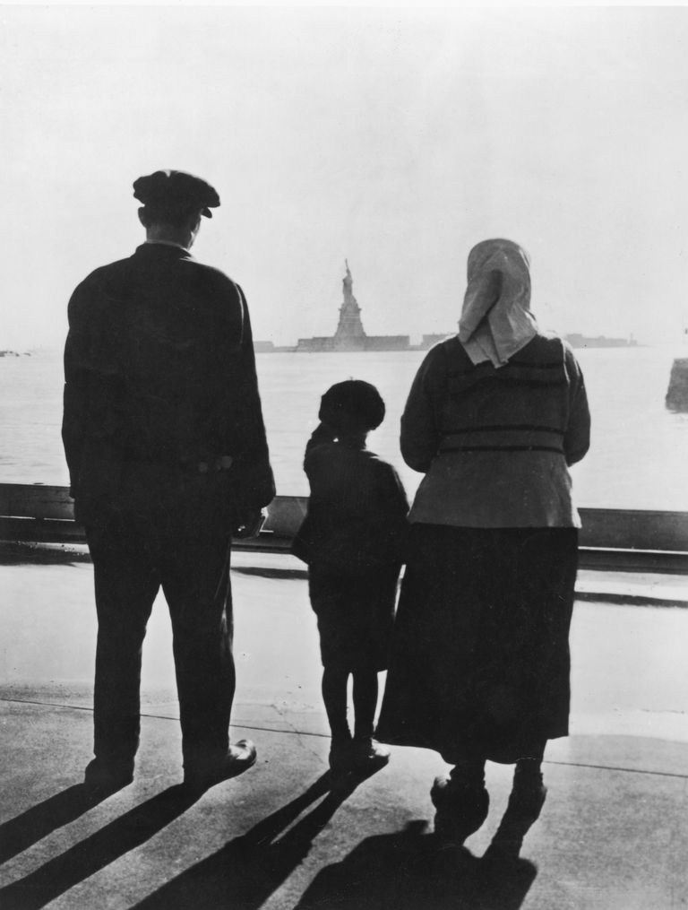A 1900s immigrant family viewing the Statue of Liberty