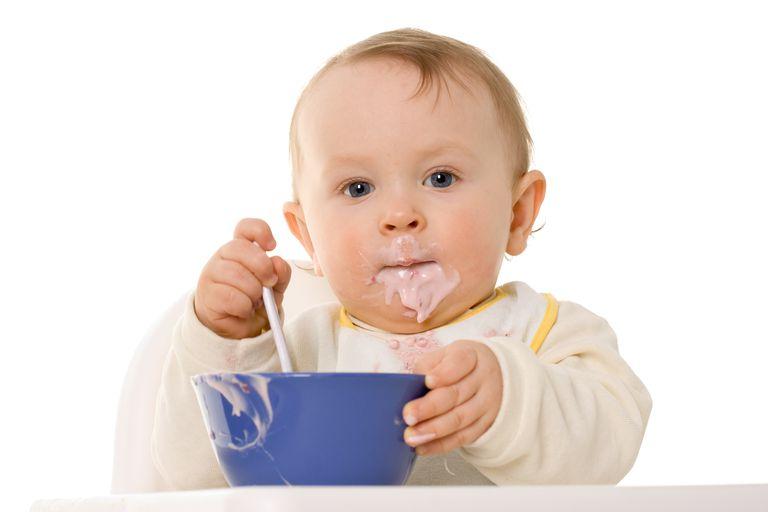 small child eating yoghurt