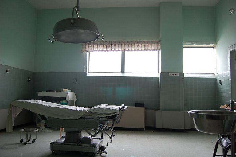 An operating room showing a surgical bed and medical equipment