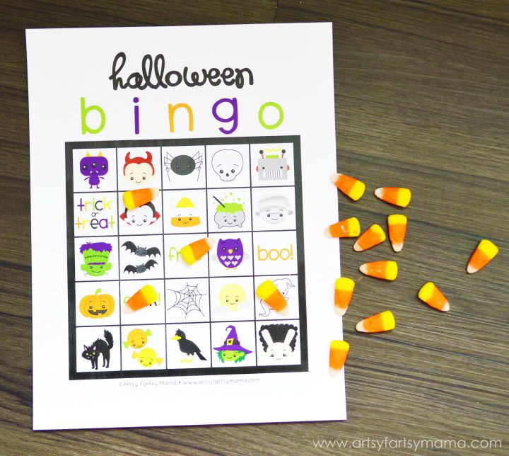 a halloween bingo card on a table with candy corn - Preschool Halloween Bingo