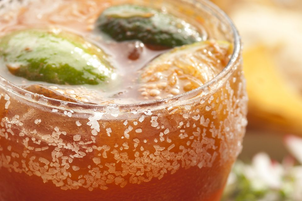 A close-up of a Michelada Mexican beer cocktail
