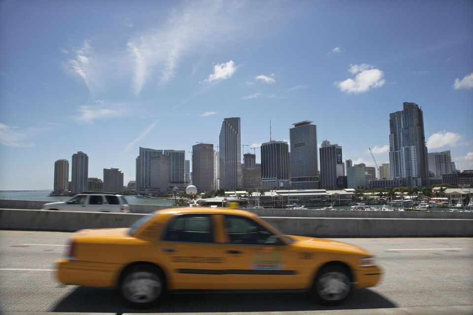 Florida, Miami skyline with blurred cab in foreground