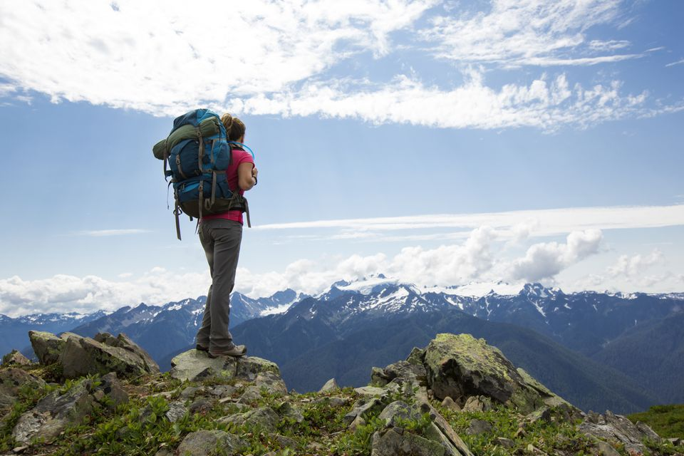 Female backpacker hiking in the mountains