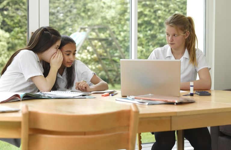 School girls bullying at desk