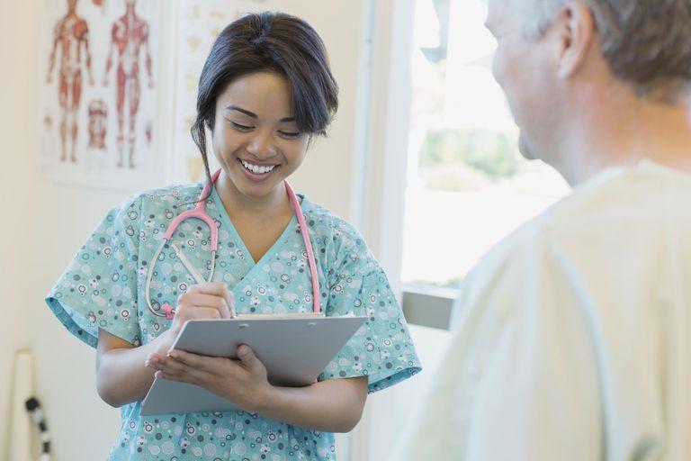 Happy nurse taking medical information
